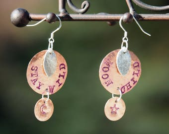 """Hand Stamped Rainbow Earrings. These say """"Stay Wild"""" on one ear, """"Moon Child"""" on the other ear. Copper and silver, handmade."""