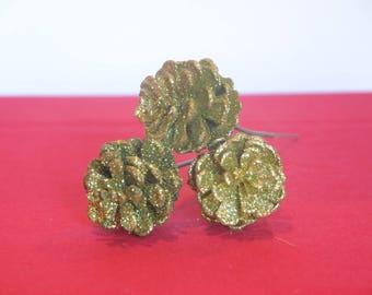 Set of three pinecones glittering Golden Spike