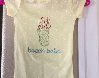 Yellow polka dotted beach babe onesie