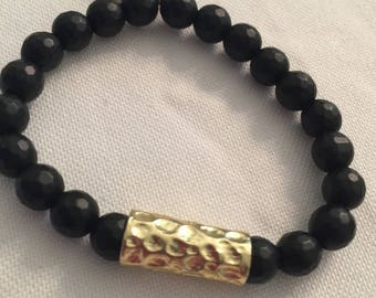Black matte beaded bracelet with chain accent