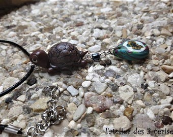 Turtle necklace with a polymer clay bead