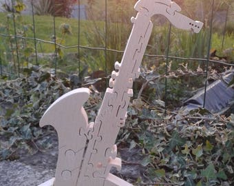 Saxophone on a solid wooden puzzle
