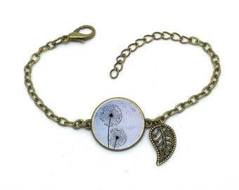 """Bracelet bleu """" Pissenlit  """", fleur ,image sous cabochon résine ,monture couleur bronze,ref bN 34"""
