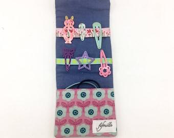little pocket barrettes and elastics