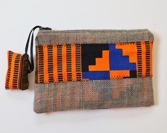 Makeup bag, orange, black and blue wax fabric