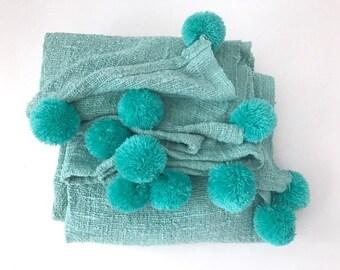 Turqousie Pom Pom blanket