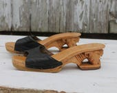 1970s foot strap heeled sandals, wooden sole, carved tiger heel, black leather upper, 7, 7.5, made in the philipines by karvings