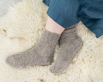 Hand knitted socks. Natural sheep wool socks from 100% sheep wool yarn. The color of the socks is natural, not painted.
