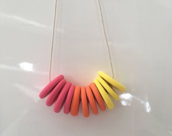 Handmade polymer clay bead disc necklace in hot pink, yellow & orange