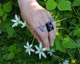 Kalopsia black metal studded vegan leather rings