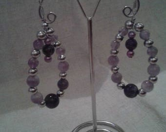 Purple beads and hoop earrings