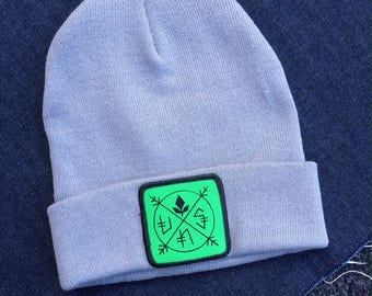 UNS Crossed Out, Uns design patch w/beanie.