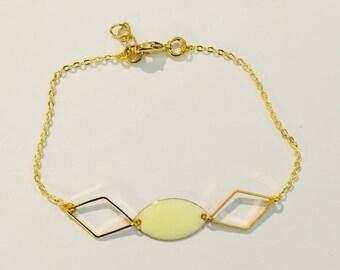 Bracelet has gold diamonds and diamond and enamel