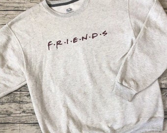 """Friends Title Sweatshirt. From the popular TV show """"Friends"""" - Light ash gray shirt with maroon writing"""