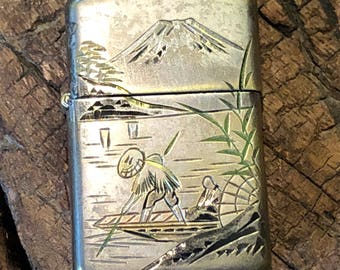 Vintage Hilldan cigarette lighter with a Japanese scene of mountains, water and a boat