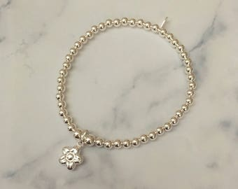 Sterling Silver stretch bracelet with Flower charm
