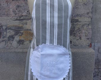Ticking and embroidered cloth apron