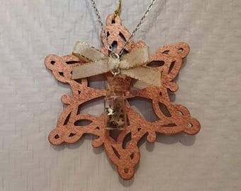 Necklace with phial and glitter star