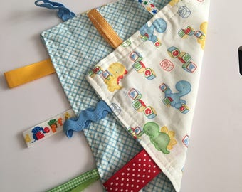 Baby dinosaurs with blue checked lovie blanket