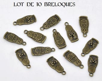 Set of 10 nesting doll charms bronze (A15)