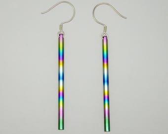 Anodized rainbow colours titanium long swinging earrings on silver hook. Titanium jewelry. Ear jewelry.