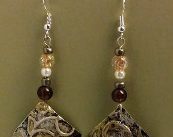 Embossed aluminum earrings with distressed antique finish.
