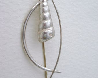 Silver brooch with cast silver shell