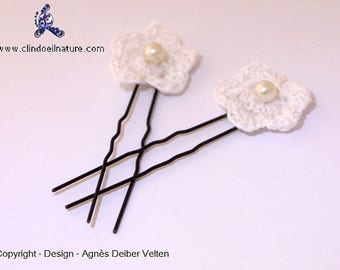 Hair pins. Adorable little crocheted flowers mounted on picks