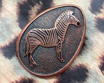 Vintage copper zebra brooch