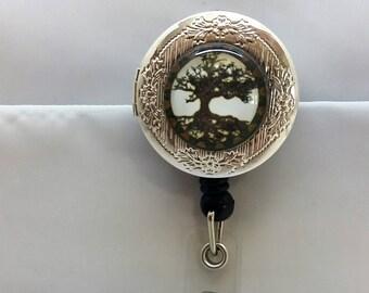Tree of Life locket badge reel
