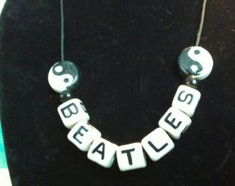 Handmade Beatles necklace resin glass beads black and white