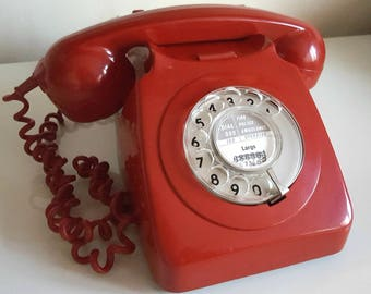 Vintage red rotatory dial telephone 1960s. Works. Tested.