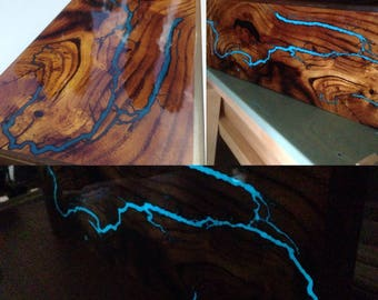 Wall decor or shelf made of mulberry with Glow-in-the-dark Lichtenberg figures in the solid clear epoxy