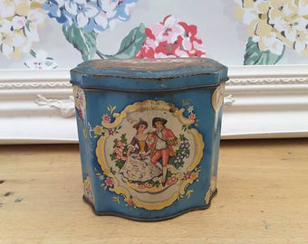Pretty Wright's vintage biscuit tin in the style of a tea tin. Beautiful imagery & colours, with Mabel Lucie Attwell image on base