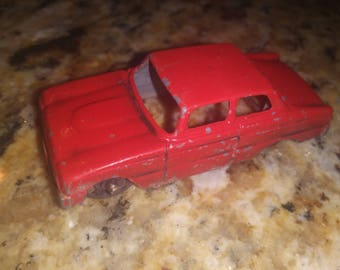 Red tootsie toy car made in chicago