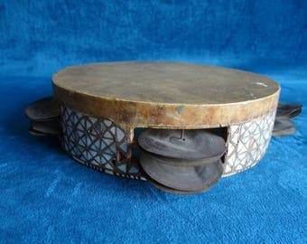 Ethnic art: African tambourine with mother of Pearl and bone