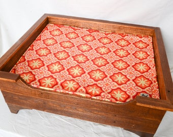 Handmade wooden dog bed for medium dogs.