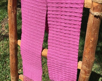 Hand woven pink scarf.