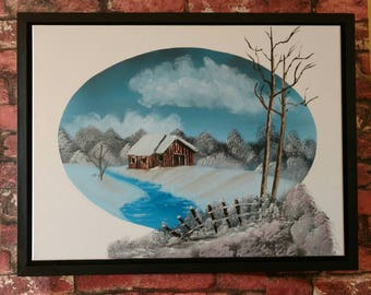 Winter scene with secluded barn by a frozen river.
