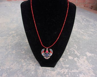 Red Beaded necklace with Egyptian Beetle charm