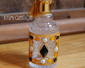 Antique gold and black perfume bottle