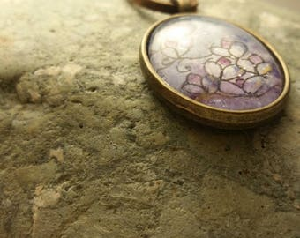 hand painted lotus flower pendant in bronze bezel