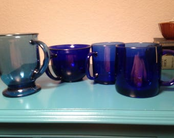 4 assorted cobalt glass mugs