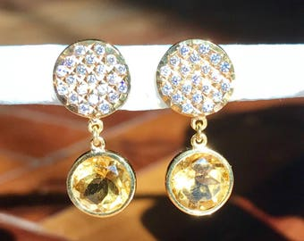 Faceted Citrine dangling earrings in 14k yellow gold with cubic zirconia.