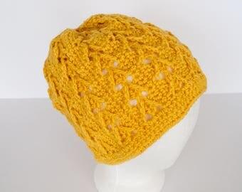 Maize colored crochet beanie with Celtic arrow stitch