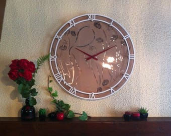 large wall clock, wood, Roman numerals, a woman with several flowers
