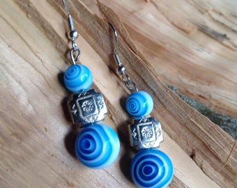 Blue and white swirly bead earrings with silver tone bead accent