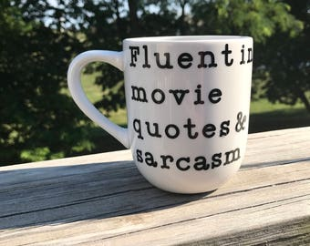 Fluent in movie quotes & sarcasm coffee mug