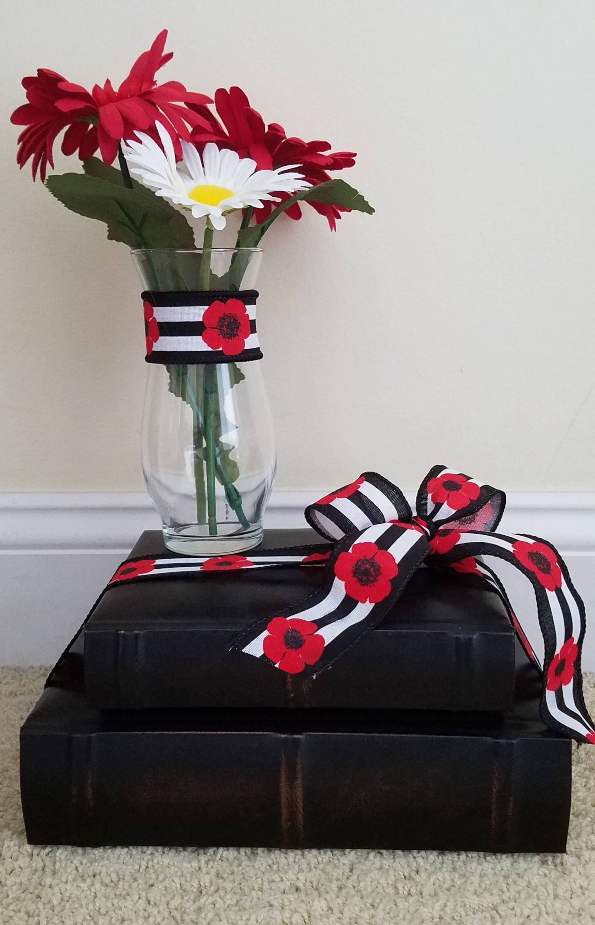 Red centerpiece graduation decorations and white