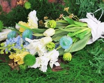 Bouquet of tulips, delphiniums and allium.